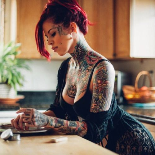A sexy tattooed redhead beauty has fun with dildo in front of the webcam 7
