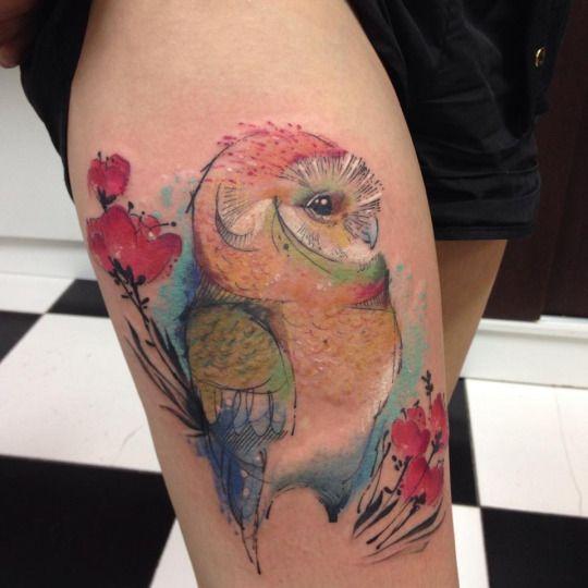 Tatuaje de buho en acuarela