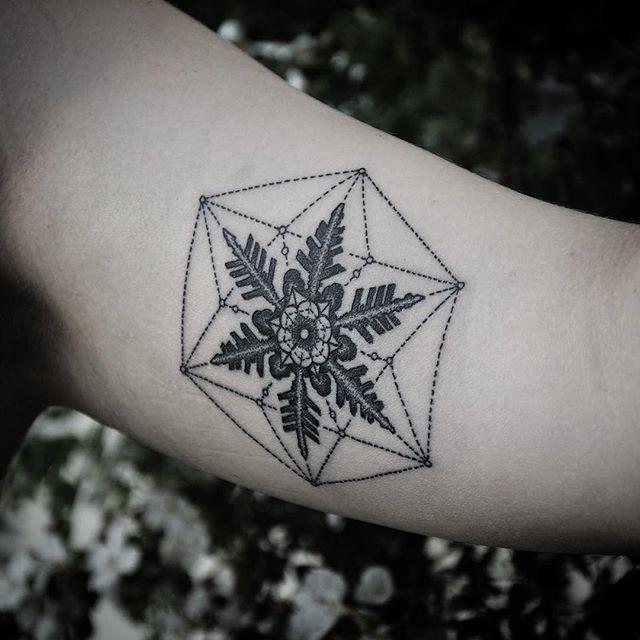 tatuado por Andy Ma.